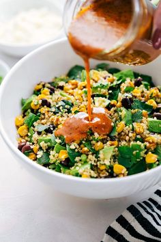 A healthy Mexican-flavor inspired avocado and corn quinoa salad packed with veggies and coated in the most delicious chipotle vinaigrette | chelseasmessyapron.com | #quinoa #salad #healthy #easy #vegetarian #quick #chipotle #dressing #spinach #health #Mexican #corn #avocado #corn #blackbeans #cilantro #greenonions