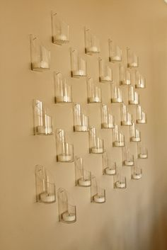Wall of glass votive holders (from CB2)
