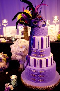 Purple and gold wedding cake with Venetian Mask