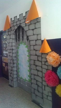 Made my classroom door into a castle. Not many of these on pintrest, so i hope this helps. Do the brickwork on the actual door in white while doing the surrounding walls in black.. to add depth. i used chalk pastels over basic grey backing paper...Chalk pastels smudge well to give the antique look. Then 'fix' it with hairspray to prevent smudging.