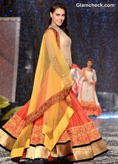 Neha Dhupia walks the ramp in a creation by designer Manish Malhotra during the Caring with Style fashion show, organised by Fevicol for Cancer Patients Aid Association India Fashion, Ethnic Fashion, Asian Fashion, Fashion Show, Style Fashion, Classic Fashion, Dress Fashion, Indian Dresses, Indian Outfits