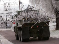 2007 ICE STORM = National guard's truck hauls away icy limbs on Fay St. SPRINGFIELD,MO
