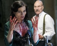 Sir Patrick Stewart in the title role looks on at his wife, Lady Macbeth, played by Kate Fleetwood.