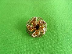 Gold-tone Pin with Dark Yellow Crystal Stones (Item 313)