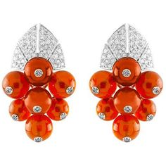 """VAN CLEEF & ARPELS  """"Heket"""" earrings from the """"Palais de la Chance"""" collection featuring round diamonds and sun opal beads set in 18K white gold. Price available upon request."""