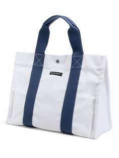 Towel?  Island Company bikini?  Lunch?  Suncare?  New sunglasses?  Pack it all for the beach in our Large Navy Island Tote!