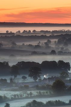 Just before sunrise over the Vale of Pewsey from Martinsell Hill, Wiltshire, England