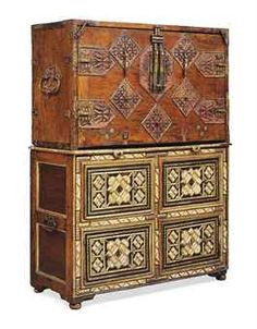 A SPANISH IRON-MOUNTED, PARCEL-GILT AND POLYCHROME-PAINTED WALNUT AND CHESTNUT VARGUENO-ON-CHEST  MID-17TH CENTURY