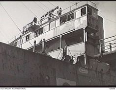 PORT MELBOURNE, VIC. 1946-02-21. JAPANESE NAVAL CREWMEN ON THE BRIDGE OF THE KOEI MARU. THE SHIP HAD JUST ARRIVED AT STATION PIER TO EMBARK 2800 JAPANESE INTERNEES FOR REPATRIATION TO JAPAN. ...