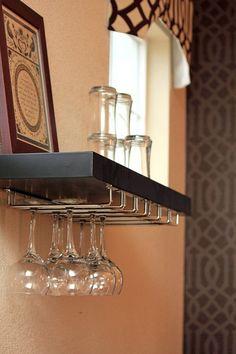 DIY floating shelf wine rack. Rack and shelf both from Lowes. Screw two racks on the underside of shelf, then hang shelf. Easy. jtstitzer
