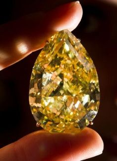 This yellow gem, called the Sun-Drop Diamond, was up for auction at Sotheby's annual jewelry auction in Geneva, Nov. 15, 2011. It sold for $10,900,000.00 plus commission... So are you saying there is only one?     =