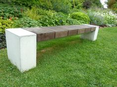 Really awesome, modern, sleek, interesting stone and wood bench #stone #bench