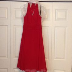 Connected Apparel size 10 Connected Apparel size 10 evening dress. Newly dry cleaned. Deep red. Halter style with gathering at waistline. Flowing bottom of skirt. Pretty Connected Apparel Dresses