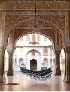 1) Chandeliers   2) beautiful and intricate arches   3) colourful hammock to relax on    - Does it get better than this!?