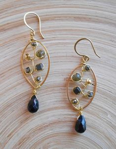 These intricately-designed Poivre noir leaf hoop earrings add a chic touch to your day or evening looks! I hand formed and hammered a leaf shaped hoop out of gold filled wire and then I wire wrapped inside it black and gray color gemstones including: pyrite faceted rondelles,