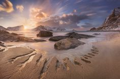Arctic beach - Lofoten islands, Haukland beach.  This day we met our first photo-workshop group with my friend Erez Marom. They were incredibly lucky to see such amazing light the first day at Lofoten. The sun was slowly rolling over the edge of white mountains for the whole hour. The main goal is to find remarkable sand structures here on the white sands of Haukland: they are forming by the tide and may dissapear very quickly.  You are welcome to join <a…