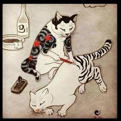 Gat tatuant-l´hi les ratlles a un altre gat.