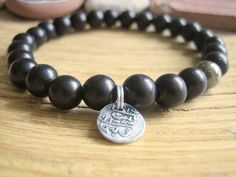 Mens Black Sandalwood Bracelet with Pyrite and Maldive Islands coin charm.