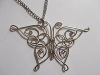 How to make a wire wrapped pendant. Celtic Butterfly Pendant  - Step 21 free tutorial