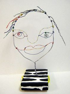 Wire portrait sculpture. Wire, colored Twisteeze, stand can be painted or stained.