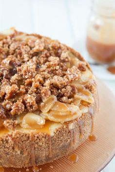 Caramel Apple Cheesecake - A creamy vanilla bean cheesecake on a cinnamon graham crust topped with a homemade apple pie filling, a crunchy streusel topping, and liberally drizzled with caramel sauce! Get the recipe on Vanilla Bean Cheesecake, Caramel Apple Cheesecake, Cheesecake Recipes, Caramel Apples, Homemade Cheesecake, Apple Caramel, Chocolate Cheesecake, Cheesecake Bites, Apple Streusel Cheesecake Recipe