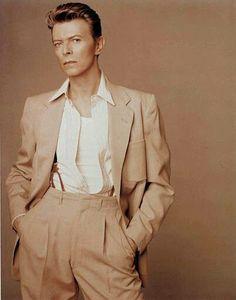 """They say the suit makes the man, but in Bowie's case, the man makes the suit, too."" #90s #gosh this is beautiful this color palette tho?"