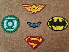 Batman Superman Wonder Woman  Green Lantern Batrang logo Bead art Superman Logo, Batman And Superman, Pixel Beads, Diy Perler Beads, Superman Wonder Woman, Pulp Fiction, Bead Patterns, Bead Art, Hobbit