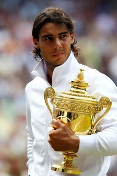 Attend 4 of the 5....Wimbeldon, French Open, Australian Open