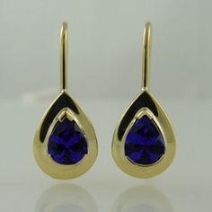 Tanzanite Earrings. A very beautiful pair of top grade Tanzanites set simply but perfectly into half bezel settings with a little extra gold to enhance the stones. Perfect for any time.