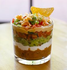 what a cute idea for a party - 7 layer dip shots