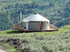 Yurt home complete with deck and solar panel.