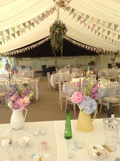 Our lovely wedding marquee that has inspired nearly 2000 others to pin onto their own boards - a worthy addition to our Wedding Inspiration board!: Summer flowers in pretty jugs look the part in this country wedding marquee Wedding Bunting, Marquee Wedding, Wedding Table, Rustic Wedding, Wedding Flowers, Wedding Reception, Wedding Themes, Wedding Venues, Wedding Decorations