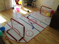 They have the nets but the floor pad is awesome, takin slap shots on my head wood lol, moms of boys problems :) # hockey humor Hockey Birthday Parties, Hockey Party, Sports Birthday, Birthday Fun, Birthday Party Themes, Birthday Ideas, Fete Vincent, Decoration, First Birthdays