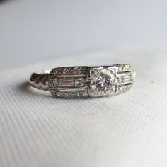 Hey, I found this really awesome Etsy listing at https://www.etsy.com/listing/164166335/platinum-art-deco-anniversary-wedding