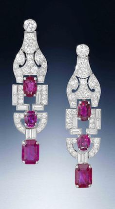 A pair of art deco ruby and diamond pendent earrings, by Cartier, circa 1930  Each brilliant-cut diamond surmount suspending an articulated pendant of geometric design, set with three graduated oval and cut-cornered rectangular step-cut rubies, the whole pierced and set throughout with old brilliant and single-cut diamonds, with baguette-cut diamond accents, diamonds approximately 3.70 carats total, each signed Cartier London