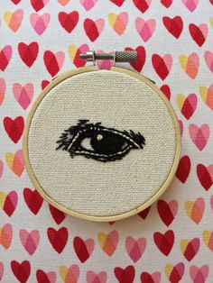 Victorians loved their disembodied body parts. Eye jewelry, ceramic hands, hair wreaths - you name it, they made it decorative and weird. And if youre into that kind of thing, like me, this antique, lovers eye-style embroidery is right up your alley. - 3 wooden hoop - cream cotton