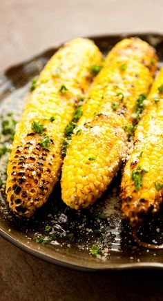 I'm going to have to step up my grill game this summer...Parmesan Garlic Grilled Corn! YUMMY!
