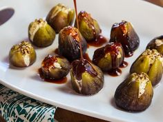 Recipe for fresh figs stuffed with goat cheese, roasted and topped with date honey. Simple and scrumptious appetizer, all natural finger food.