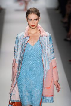We think this coat is absolutely to DIE for! a ladylike take on the luxe sport trend, the luxe pastel fur softens the clean geometry and sporty collar and zipper on this fabulous look from @Dennis Basso #nyfw #mbfw #ss14