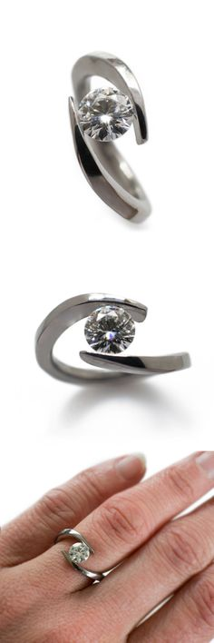 1 carat moissanite engagement ring in titanium. It appears as though the moissanite is held between two gently flowing waves - Casavir Jewelry