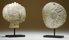 Whelk shell gorgets from Spiro mounds site, 1200-1350 AD. Eye-in-Hand and apparent sun motifs.
