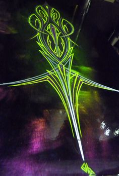 Lime green pin striping on a dark metal panel