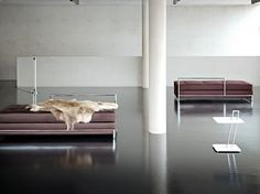 Day bed, Tube light and Occasional table by Eileen Gray