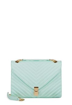 The color of this bag is perfect for spring! I love the clasp.