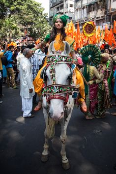 Maharashtrian women dressed in traditional costumes perform during a procession.r #GudiPadwa