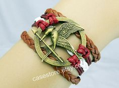 Mockingjay pin braceletred and red Brownleather by charmcover, $7.99