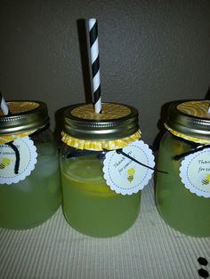 Mason jars covered with a cupcake liner. I used yarn to hold the tag to give it the fuzzy feel of bees.