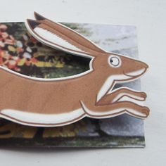 I do like a big bunny, and a leaping, shrink plastic hare is even better! I can't tell you how much fun it is to put a larger version of your design in the oven and watch it curl and shrink down, down, down! This particular brooch measures approximatel. Big Bunny, Hare, Beautiful Creatures, Things To Come, Brooch, Rabbits, Mystic, Fun, Yellow