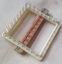 Pin loom with adjustable bar to weave thinner rectangles. Adjustable bar made from an oak strip and a metal dog comb (some teeth removed). Carved  oak strip to hold the dog comb stable on the weave it loom.