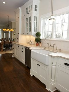Sink with cabinet detail + chandelier. I love it all!